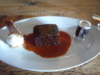 Sticky toffee pudding with peanut brittle ice cream and some stout