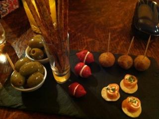 Canapes - olives, cheese sticks, beetroot meringues, smoked salmon roulade, fishcake balls