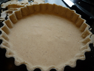 Using a sharp knife, cut off excess pastry flush wth the tin