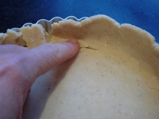 Use your finger to work in all the cracks in the pastry
