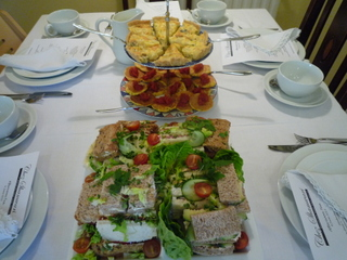 Table set with finger sarnies & warm savouries