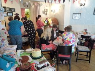 Inside Jeanette's Cakery enjoyng cake!